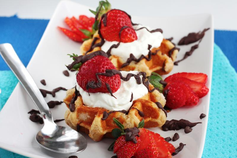 Strawberry waffles with cream and chocolate stock photo