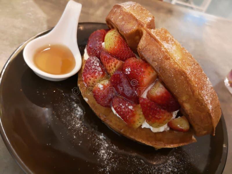 Strawberry waffles stock photography