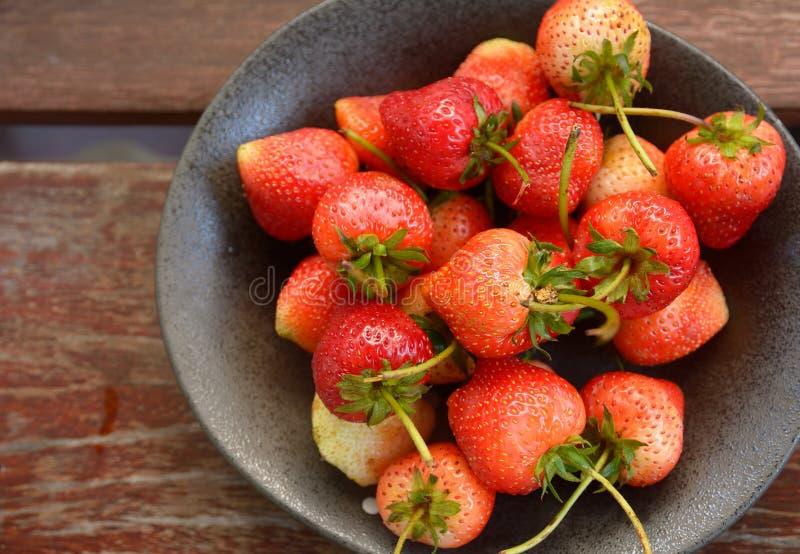 Strawberry on wood background stock photo