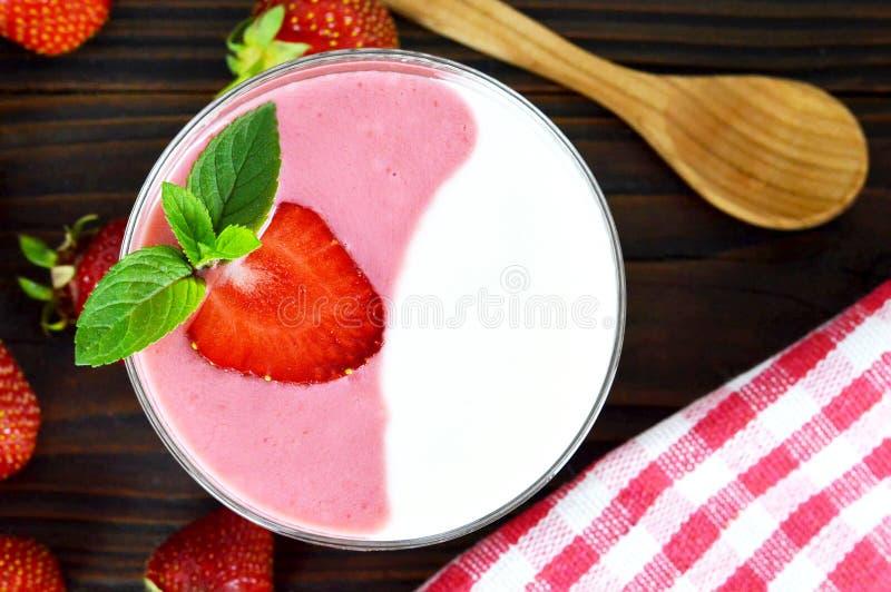 Strawberry yogurt and fresh strawberries stock photos