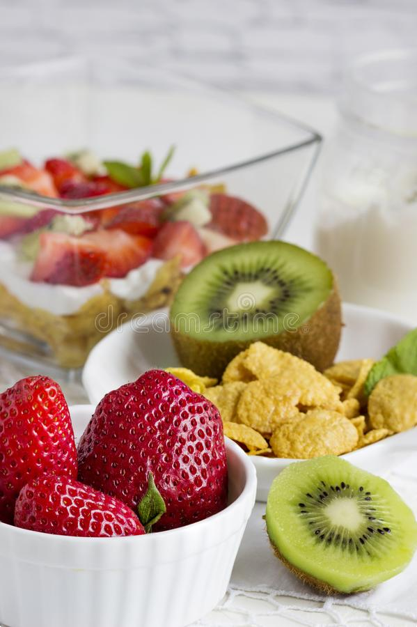 Strawberry, yogurt and muesli. Healthy breakfast -fresh berries royalty free stock photos