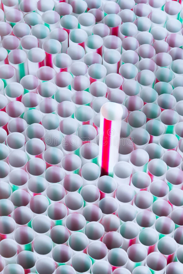 Straws green and red. A straw with red stripes emerging in the middle of many straws with red and green stripes royalty free stock image