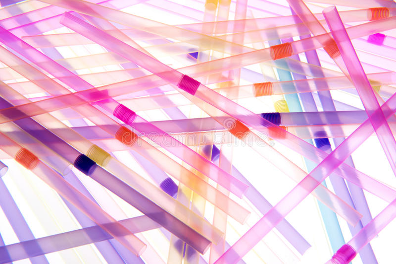 Straws of Many Vibrant Colors. Macro view of multi-colored straws on white background royalty free stock image