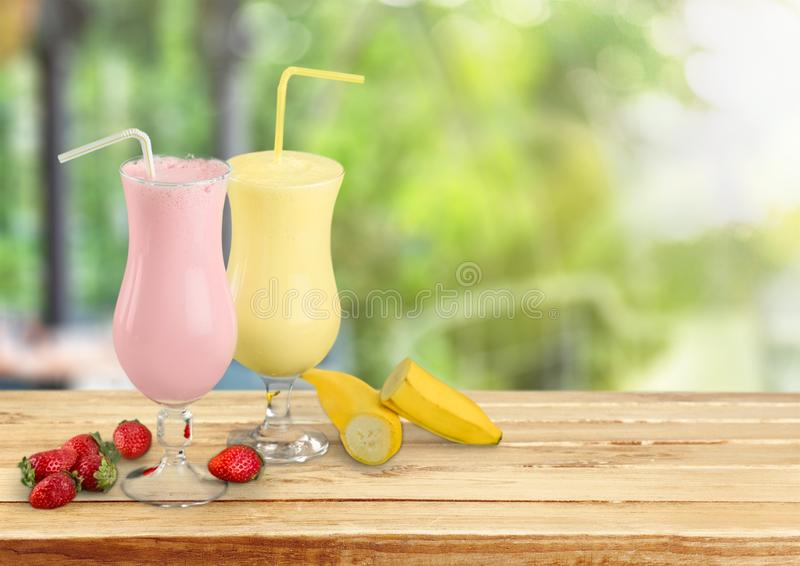 Fruit Smoothies with Straws Isolated on. Straws smoothies color background nobody isolated closeup royalty free stock photography