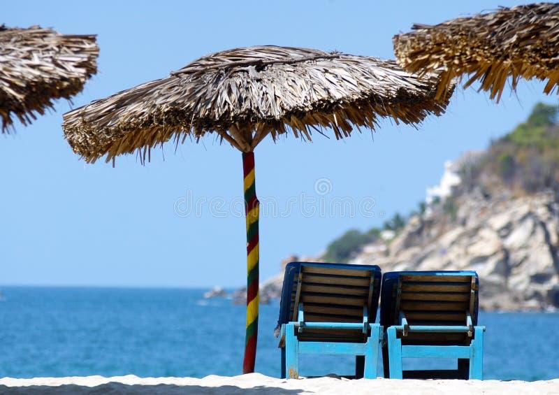 Strawy ubrellas, Puerto Escondido, Mexico royalty free stock image