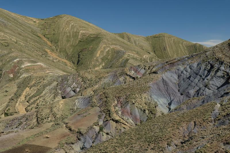 Streaked green and rainbow mountains in Maragua Crater. Bolivia stock photo