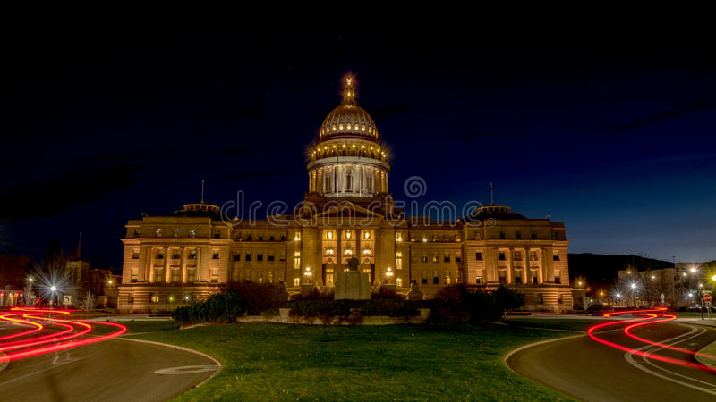 Streaking car lights lead to Idaho capital building. Night view of Idaho capital with stars and car lights royalty free stock photography