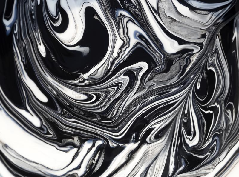 Streaks and patterns when mixing white paint with black pigment before staining. Streaks and patterns when mixing white paint with black pigment  before staining stock image
