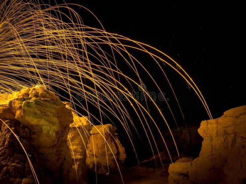 Steel wool arcs over cliffs stock image