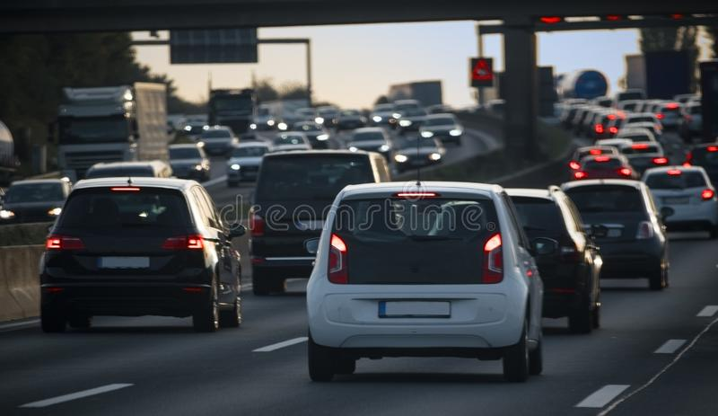 Stream of cars, congestion and traffic jam at rush hour on the f royalty free stock photo