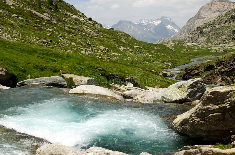 Stream and falls in the mountains, Alps, France stock photo