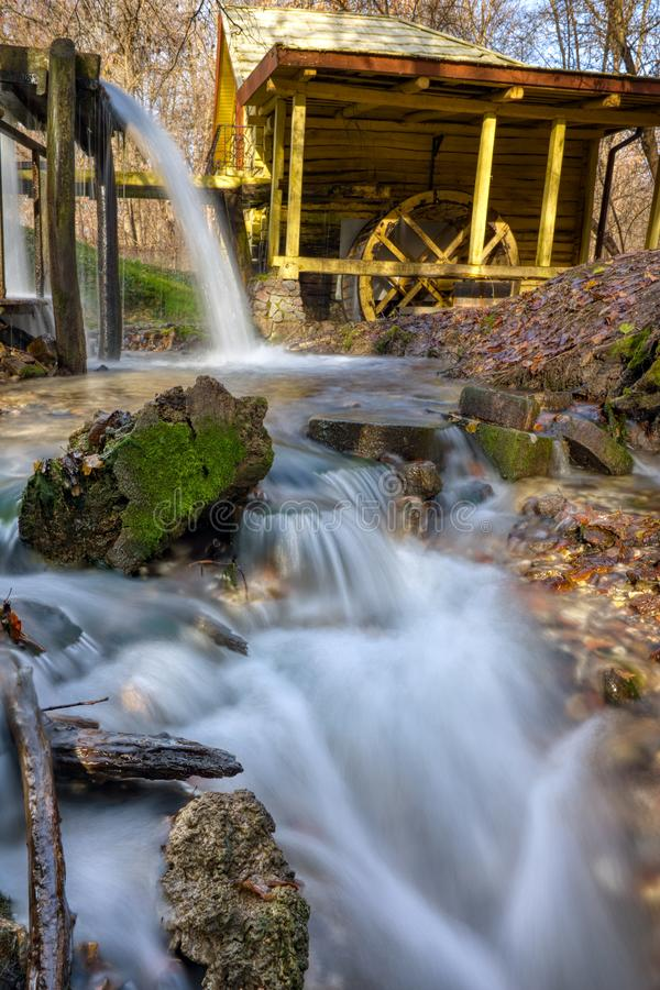 A stream of flowing clean spring water in an old mill. Photo taken in autumn in Russia stock photo