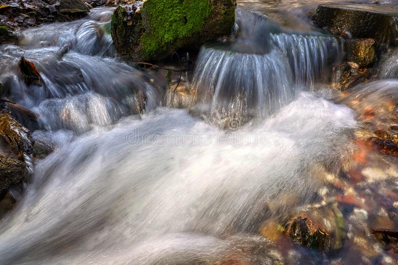 Stream flowing clean spring water. Photo taken in autumn. In Russia stock photo
