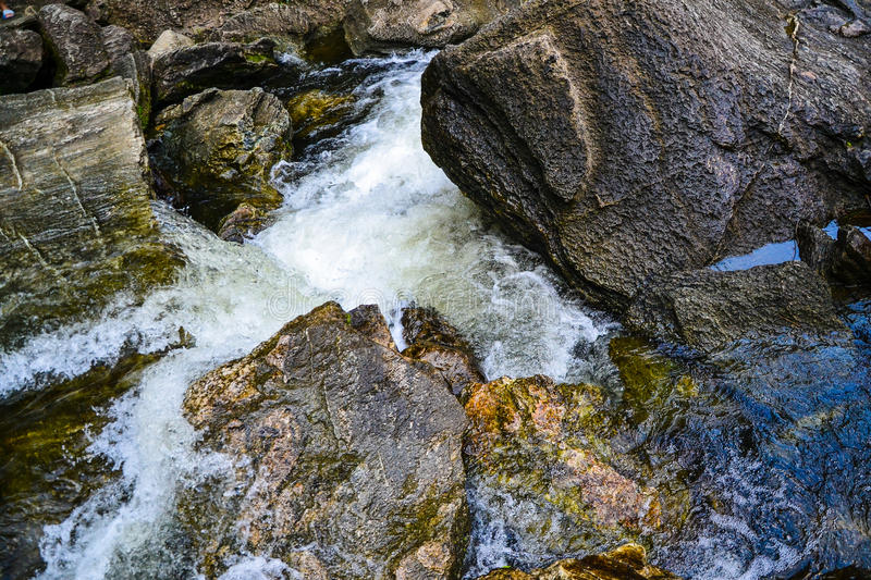 A stream that flows down from the waterfall. stock photo
