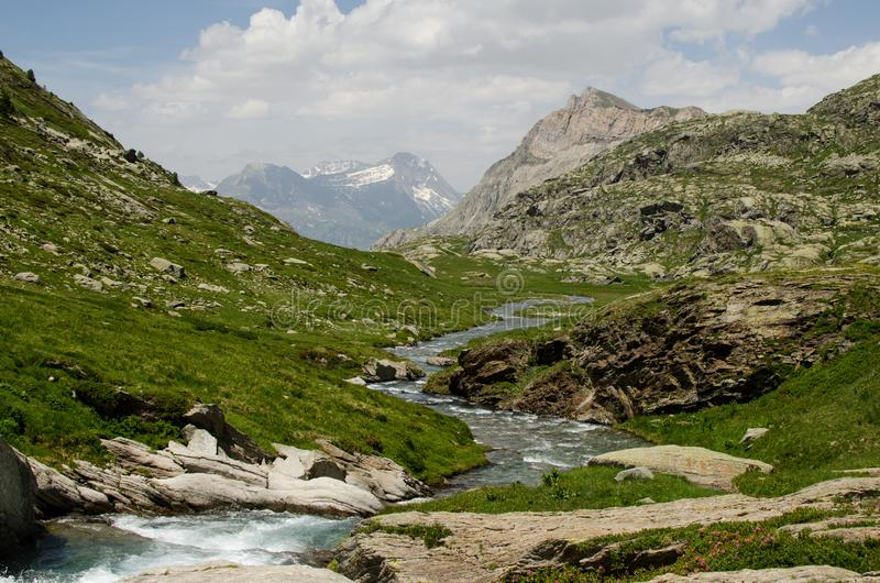 Stream in the valley of the mountains, Alps, France stock image