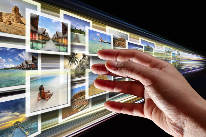 Streaming multimedia from the internet. Hand reaching streaming multimedia from the internet