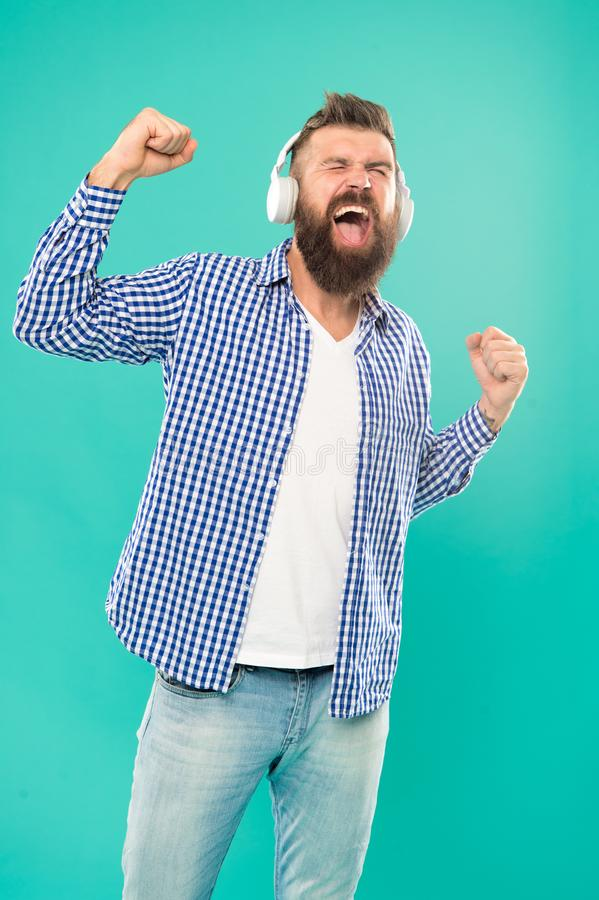 Streaming music sites hippest and hottest around. Wireless technology. User friendly interface and large library of. Tunes. Hipster with beard listening music stock photo