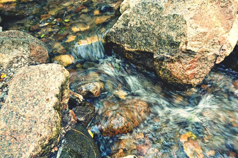 Streaming river cascade on the rocks nature landscape outdoors awesome beauty background royalty free stock images