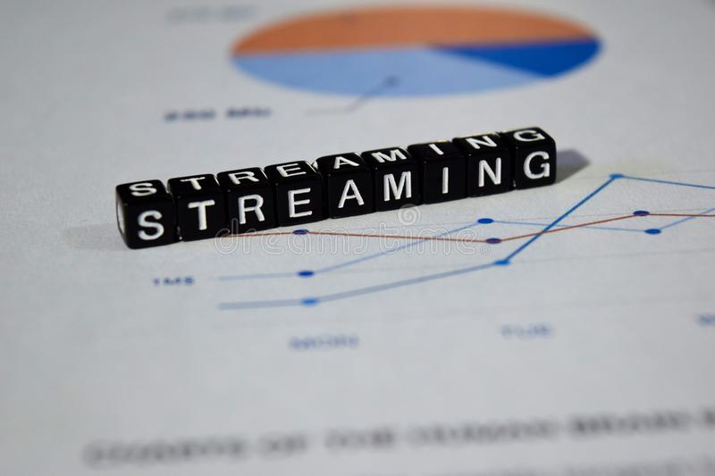 Streaming on wooden blocks. Technology Data Network Transfer Concept stock images