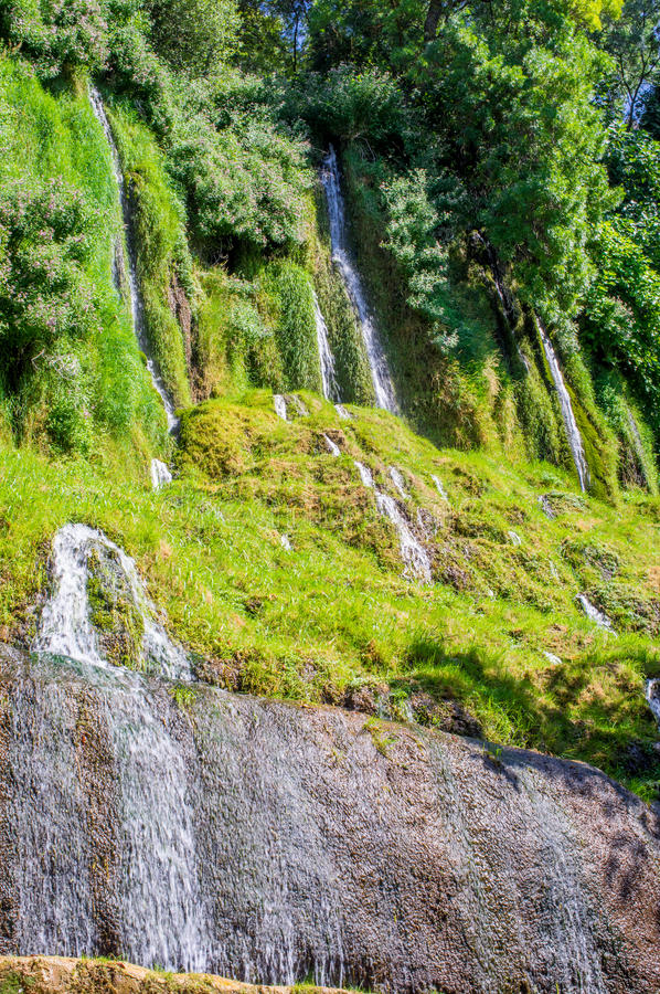 The streams of water coming down from the hill royalty free stock photos