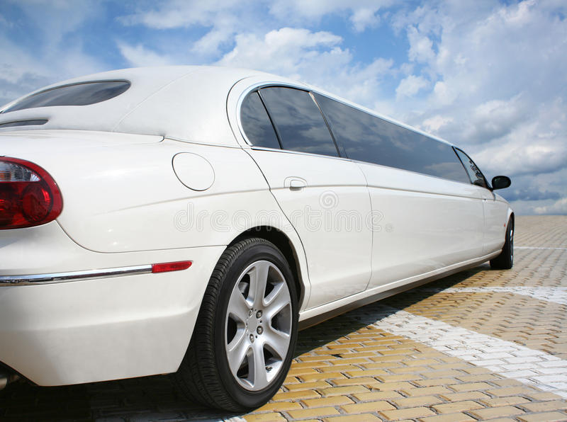 Strech Limousine. Stretch white limousine on a yellow cobbles stock photography