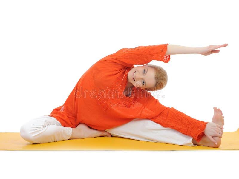 Streching Serien- oder Yogaphotos.young Frau stockfotografie