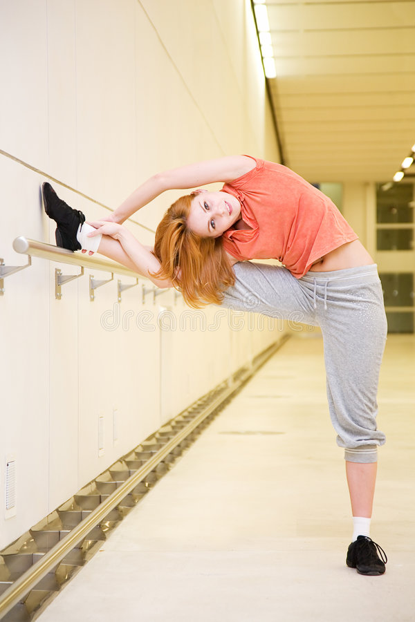 Streching woman royalty free stock photography