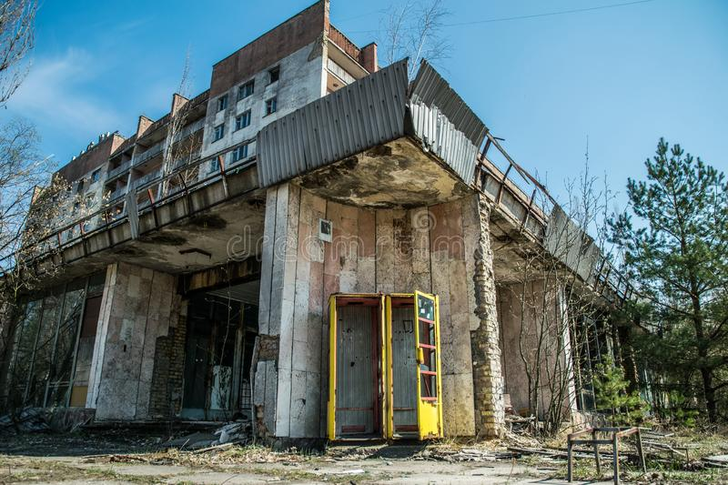 Street of the abandoned ghost town Pripyat. Overgrown trees and collapsing houses in the exclusion zone of the Chernobyl nuclear d royalty free stock photos
