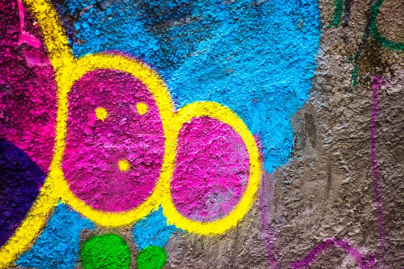 Street abstract bright colorful graffiti on a concrete wall. Urban culture background of street art graffiti stock photos