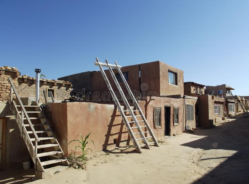 A street in Acoma Pueblo, New Mexico. Traditional adobe pueblo on a mesa top, home to the native Acoma people stock photos