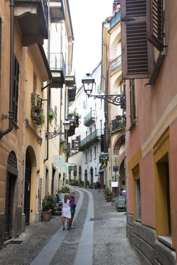 Street in Acqui Terme, Italy. ACQUI TERME, ITALY - JULY 2016: Typical houses in the small mountain village Acqui Terme in the north of Italy royalty free stock image