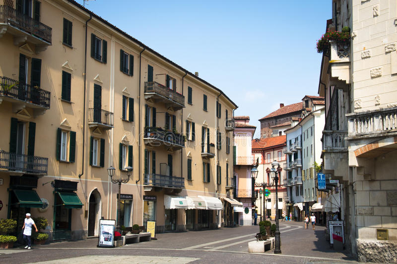 Street in Acqui Terme, Italy. ACQUI TERME, ITALY - JULY 2016: Typical houses in the small mountain village Acqui Terme in the north of Italy stock photo