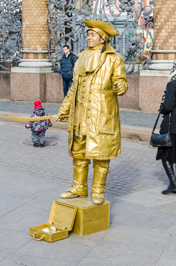 A street actor dressed as a gold pirate near Church of the Savior on Spilled Blood. stock images