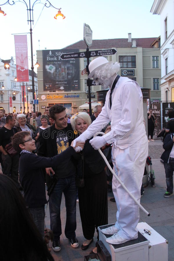 Download Man In White - Living Statue Handshake Editorial Image - Image: 31514000