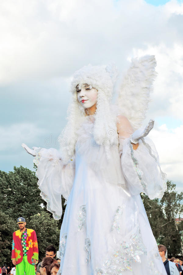 Street actor woman dressed like an angel poses for photos in Moscow stock images