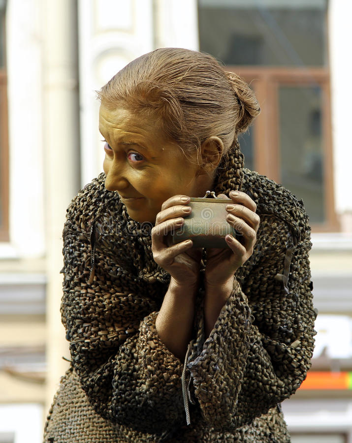 Street actress living statue in the image of a greedy old woman from famous novel by Fyodor Dostoevsky, `Crime and Punishment`. St. PETERSBURG, RUSSIA - JUL 5 stock images