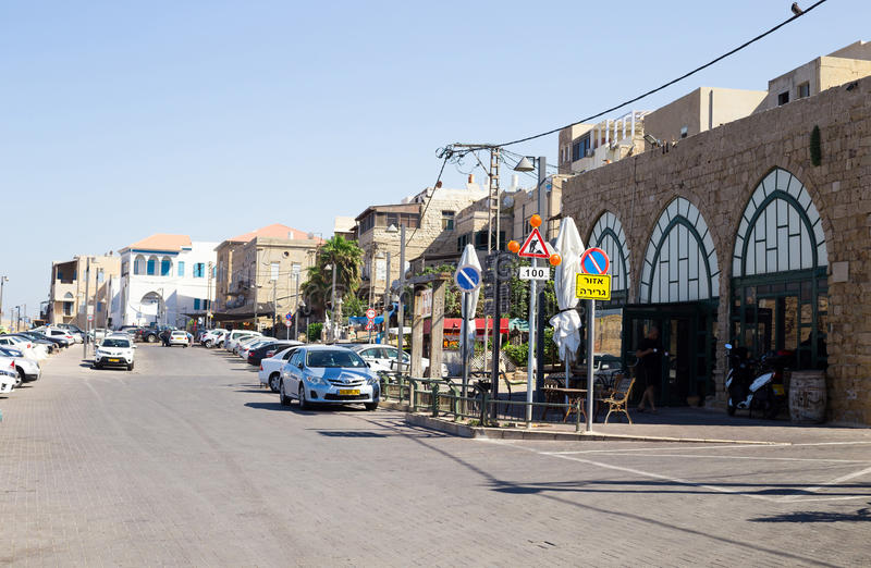 A street in Akko Acre, Israel. City street with cars, resident stock images