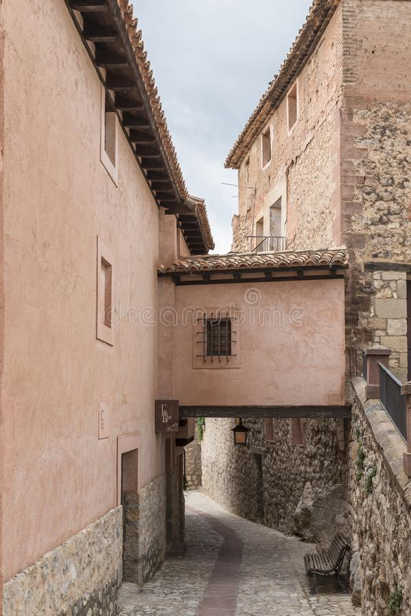 street of Albarracín with gallery that connects two facing buildings, Teruel, Spain royalty free stock photography