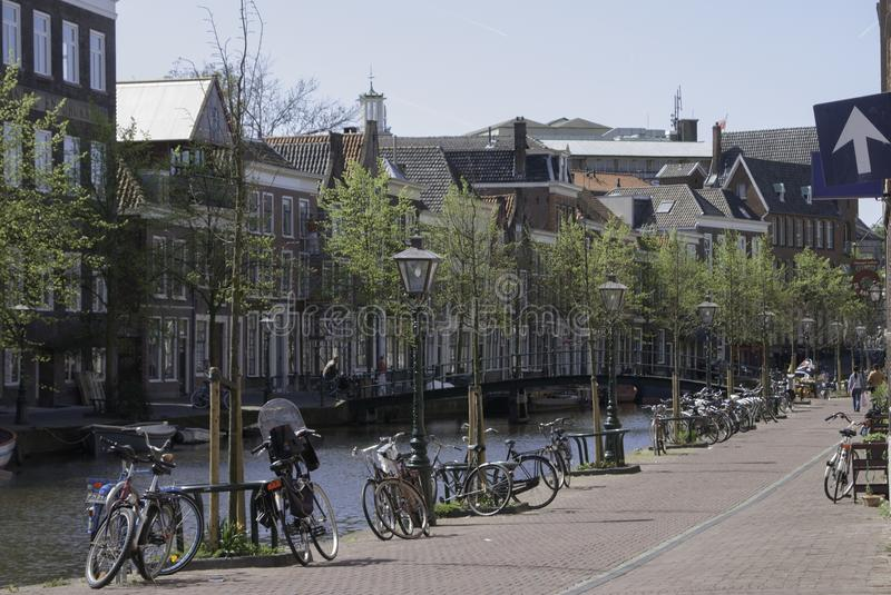 Leiden Netherlands street along a canal. Street along a canal in Leiden Netherlands with lots of bicycles royalty free stock photo