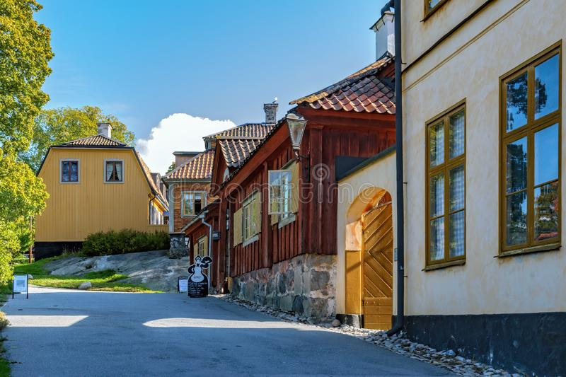 Street along various colorful ancient houses in Old Town Quarter in Skansen open-air museum. Stockholm, Sweden royalty free stock photos