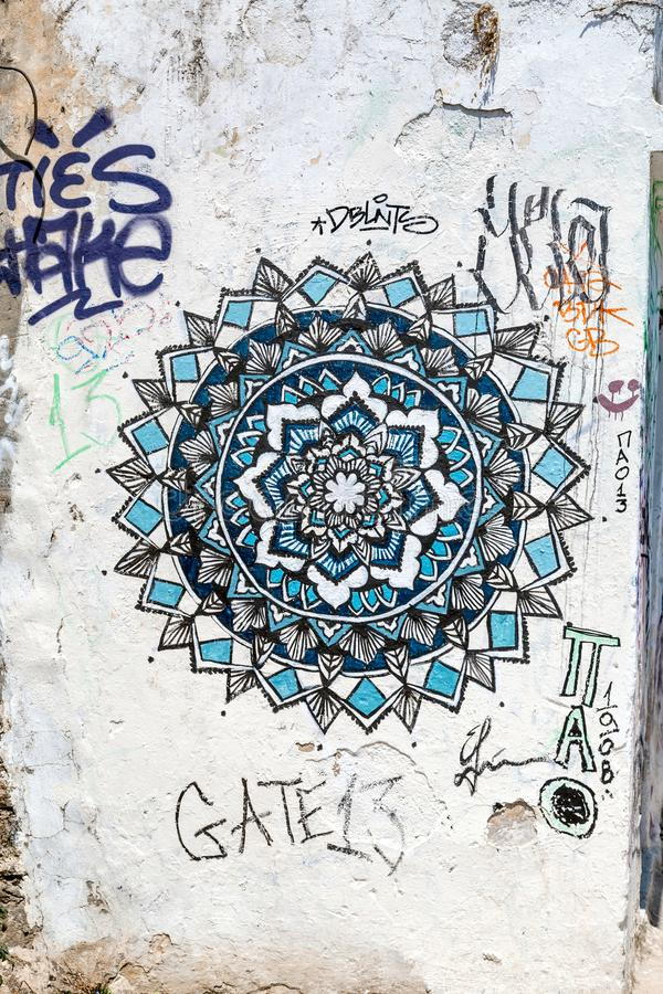 Street Art in Athens. Athens, Greece - July 21, 2018: Graffiti street art on the walls of buildings in Athens. The whole city is covered with creative mural stock photography
