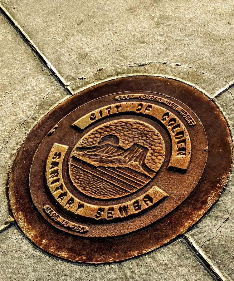Golden manhole cover royalty free stock images