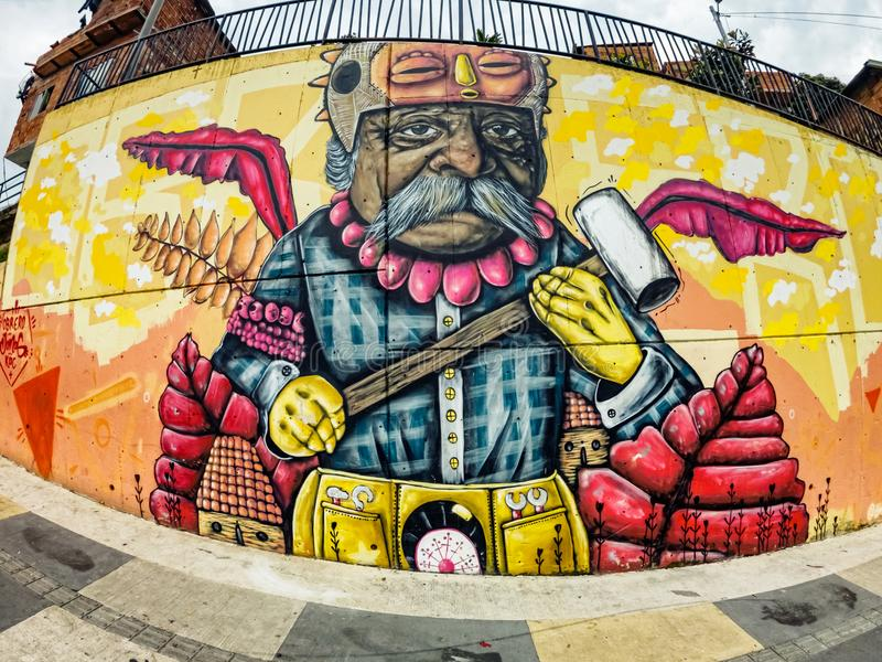 Street art graffiti on a wall in the street of Medellin, Colombia. Medellin, Colombia - March 28, 2018: Street art graffiti on a wall in area called Comuna 13 royalty free stock image