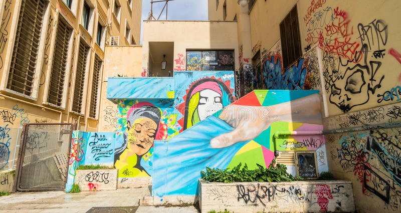 Street art and graffiti on wall in Potenza, Italy. POTENZA, ITALY - MARCH 13, 2015: urban wall with street art and graffiti in Potenza, Italy. Potenza is the stock images