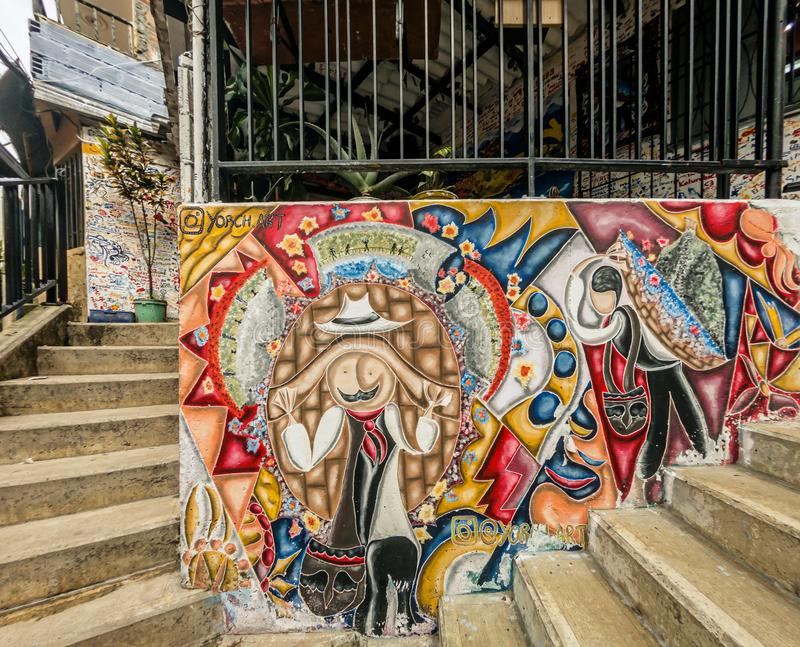Street art graffiti on a wall in the street of Medellin, Colombia. Medellin, Colombia - March 28, 2018: Street art graffiti on a wall in area called Comuna 13 royalty free stock photo