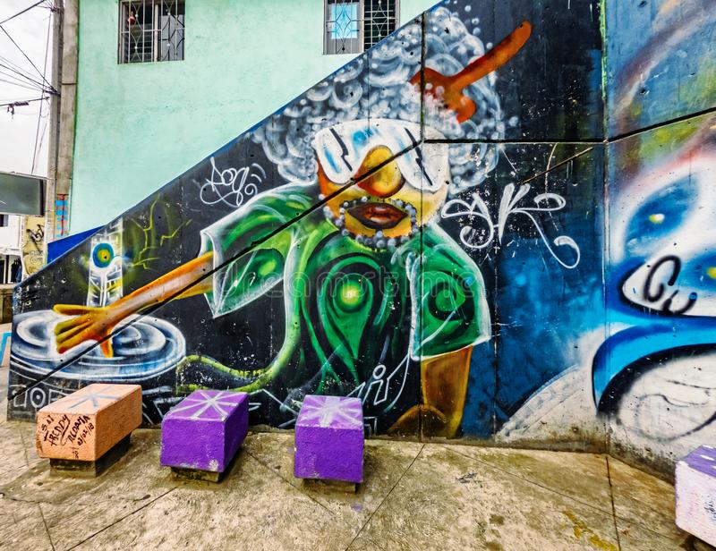 Street art graffiti on a wall in the street of Medellin, Colombia. Medellin, Colombia - March 28, 2018: Street art graffiti on a wall in area called Comuna 13 stock images