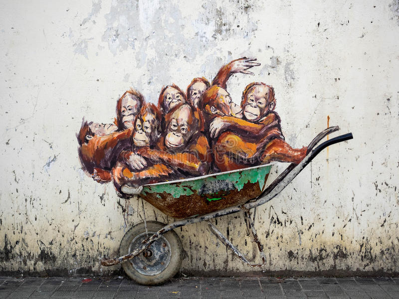 Street Art in Kuching, Sarawak, Malaysia. Orangutans in a wheelbarrow street art mural by Lithuanian artist Ernest Zacharevic in Kuching, Sarawak State, Malaysia stock photos