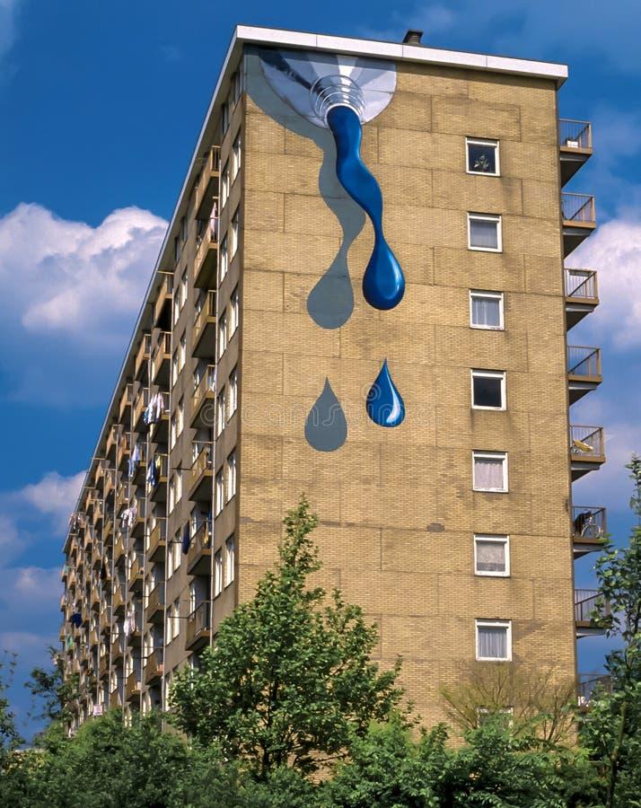 Street art mural paint tube, Holland. Paint tube as mural street art on wall apartment building in Nieuwegein, Netherlands stock image