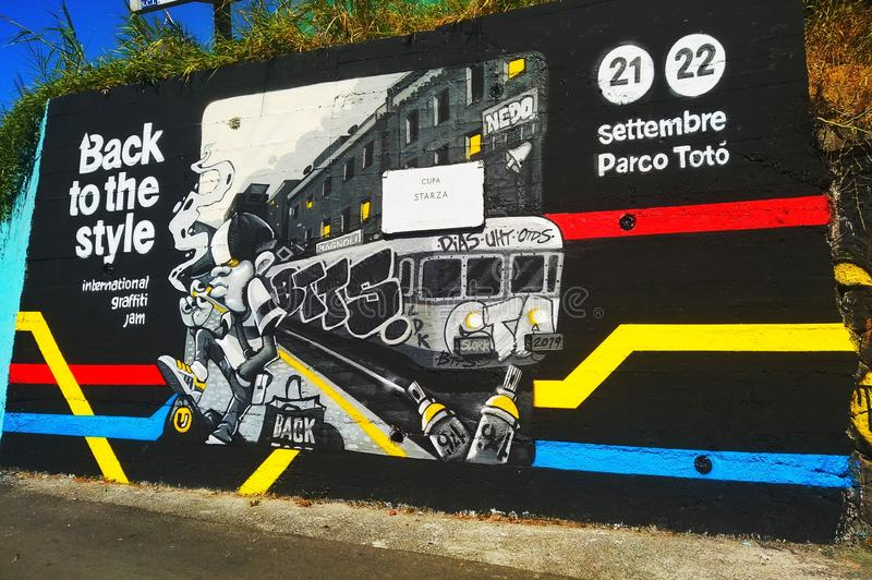 Street art in Naples, Italy. Cupa, starzs, starza, graffiti, train, red, yellow, blue, black, white, style, september, colours, sky royalty free stock photography