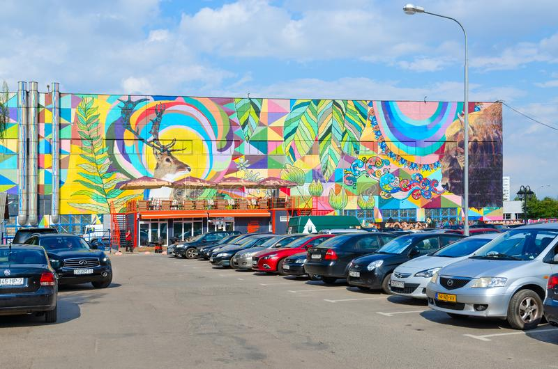 Street art on Oktyabrskaya street. Graffiti with natural motifs on wall of industrial building, Minsk, Belarus. MINSK, BELARUS - AUGUST 12, 2019: Street art on royalty free stock photo